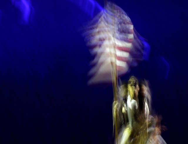 A rider brings out the American flag before the National Circuit Finals Rodeo at the State Fair Arena in Oklahoma City, Thursday, April 4, 2013. Photo by Bryan Terry, The Oklahoman