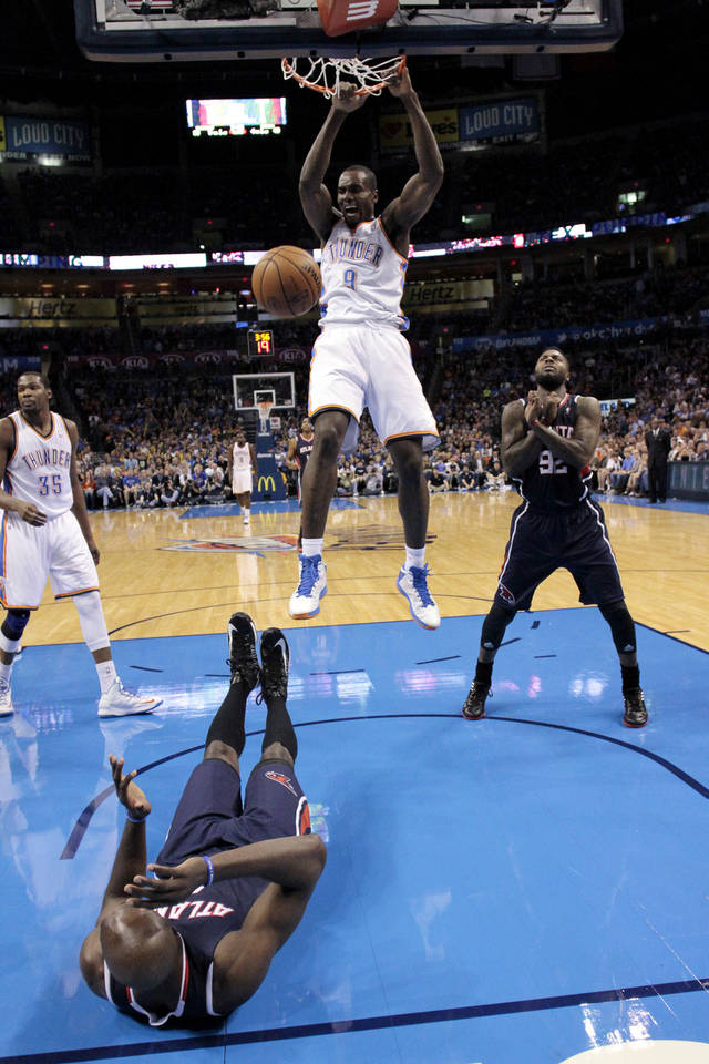 Oklahoma City Thunder's Serge Ibaka (9) scores as the Atlanta Hawks defeat the Oklahoma City Thunder 104-95 in NBA basketball at the Chesapeake Energy Arena in Oklahoma City, on Sunday, Nov. 4, 2012.  Photo by Steve Sisney, The Oklahoman