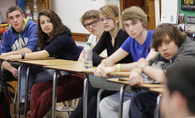 French exchange students listen to questions about their country during class at Harding Charter Preparatory High School Friday, March 2, 2012. The students found Oklahomans who had died in wars that France and America had fought together in. Photo by Doug Hoke, The Oklahoman