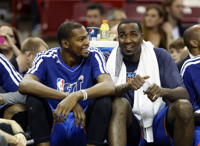 Oklahoma City Thunder's Kevin Durant, left, and Kendrick Perkins smile as the relax on the bench in the closing moment of an NBA basketball game against the Sacramento Kings in Sacramento, Calif., Friday, Jan. 25, 2013. The Thunder won 105-95. (AP Photo/Rich Pedroncelli) ORG XMIT: SCA115