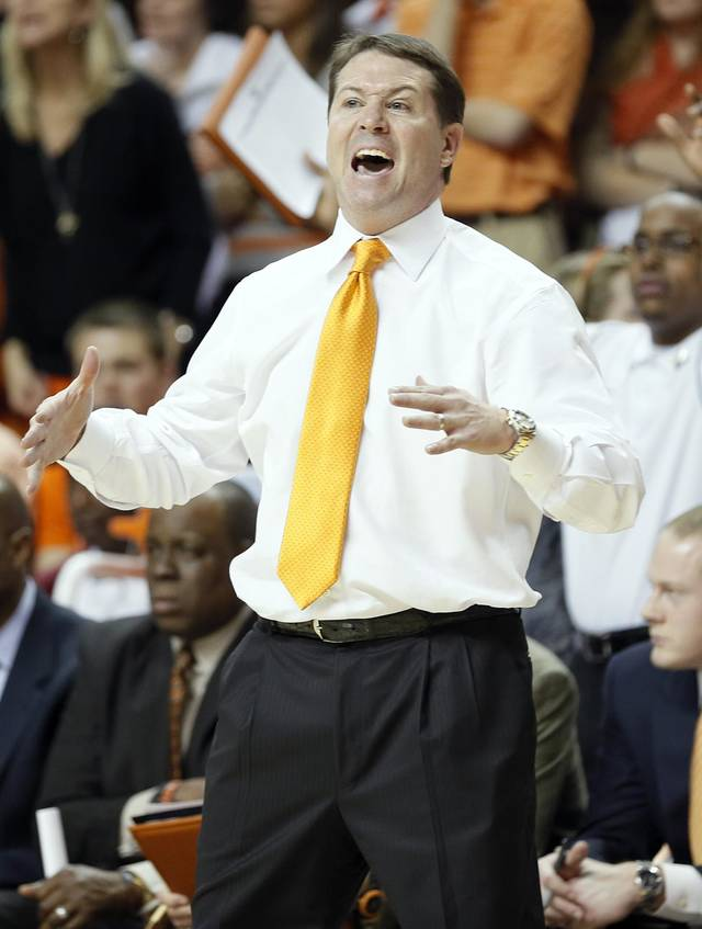 Travis Ford yells at his team during the college basketball game between the Oklahoma State University Cowboys (OSU) and the Baylor University Bears (BU) at Gallagher-Iba Arena on Wednesday, Feb. 5, 2013, in Stillwater, Okla. Photo by Chris Landsberger, The Oklahoman