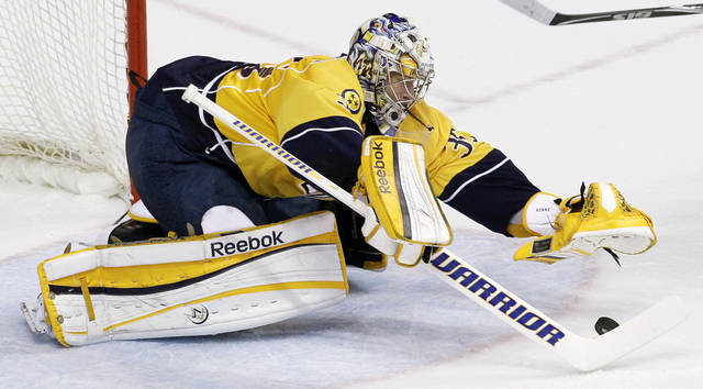Nashville Predators goalie Pekka Rinne, of Finland, dives on a puck in the first period of Game 3 against the Phoenix Coyotes in an NHL hockey Stanley Cup Western Conference semifinal playoff series on Wednesday, May 2, 2012, in Nashville, Tenn. (AP Photo/Mark Humphrey)