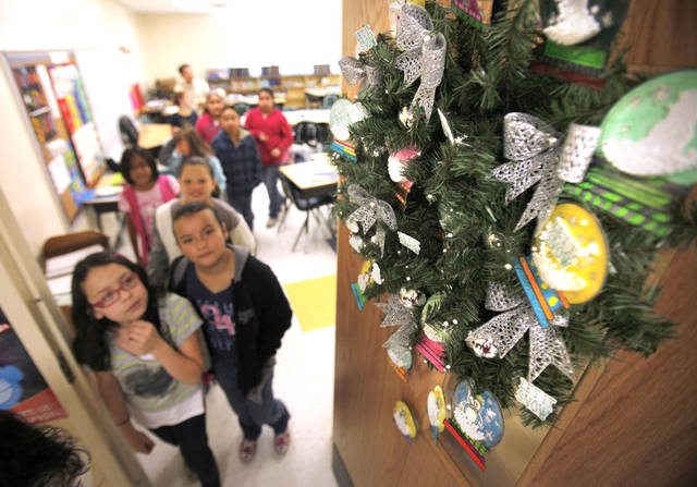Fourth-graders walk past their wreath at Fillmore Elementary School in Oklahoma City, OK, Tuesday, Nov. 15, 2011. All the students at Fillmore Elementary created 30 wreaths which Integris will auction off, with all the money going back to the school. By Paul Hellstern, The Oklahoman