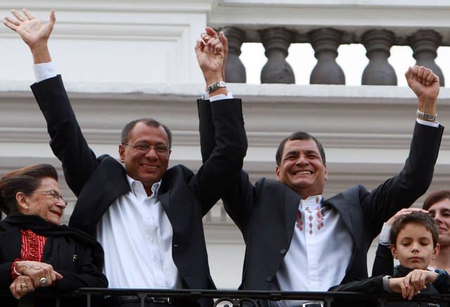 Ecuador&#039;s President and candidate for re-election Rafael Correa, top right, and vice presidential candidate Jorge Glass, top left, accompanied by relatives, celebrate after presidential elections in Quito, Ecuador, Sunday, Feb. 17, 2013. Although official results had still not been released, Correa celebrated his second re-election as Ecuador&#039;s president after an exit poll showed him leading by a wide margin. (AP Photo/Martin Jaramillo)