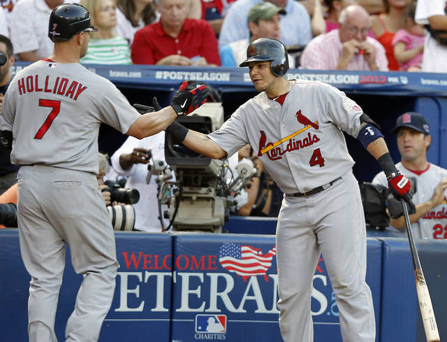   St. Louis Cardinals&#039; Matt Holliday (7) reacts to his solo home run with teammate Yadier Molina (4) during the sixth inning of the National League wild card playoff baseball game against the Atlanta Braves, Friday, Oct. 5, 2012, in Atlanta. (AP Photo/John Bazemore)  