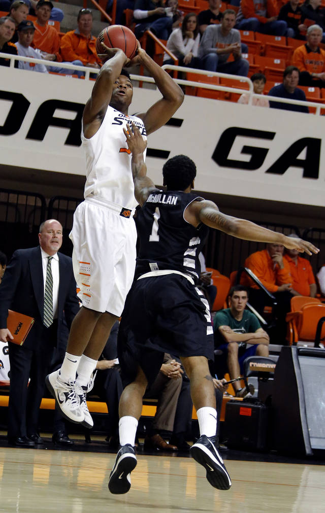 Marcus Smart (33) shoots over Lateef McMullan (1) during the college basketball game between Oklahoma State University and Portland State, Sunday,Nov. 25, 2012. Photo by Sarah Phipps, The Oklahoman