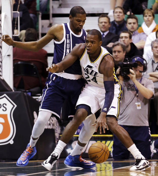 Oklahoma City Thunder's Kevin Durant, left, defends against Utah Jazz's Paul Millsap (24) in the first quarter of an NBA basketball game, Tuesday, Feb. 12, 2013, in Salt Lake City. (AP Photo/Rick Bowmer) ORG XMIT: UTRB106