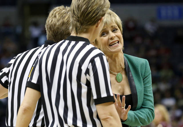 Baylor head coach Kim Mulkey talks with officials in the first half of a regional semifinal game in the women's NCAA college basketball tournament in Oklahoma City, Sunday, March 31, 2013.  Louisville won 82-81. (AP Photo/Sue Ogrocki) ORG XMIT: OKSO126