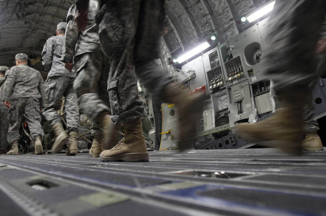 In this Saturday, Dec. 17, 2011 photo, U.S. Army soldiers from the 25th Infantry Division board a plane at Camp Adder moments before the unit leaves Iraq. The U.S. military says the last American troops have left Iraq as the nearly nine-year war ends. (AP Photo/Maya Alleruzzo)