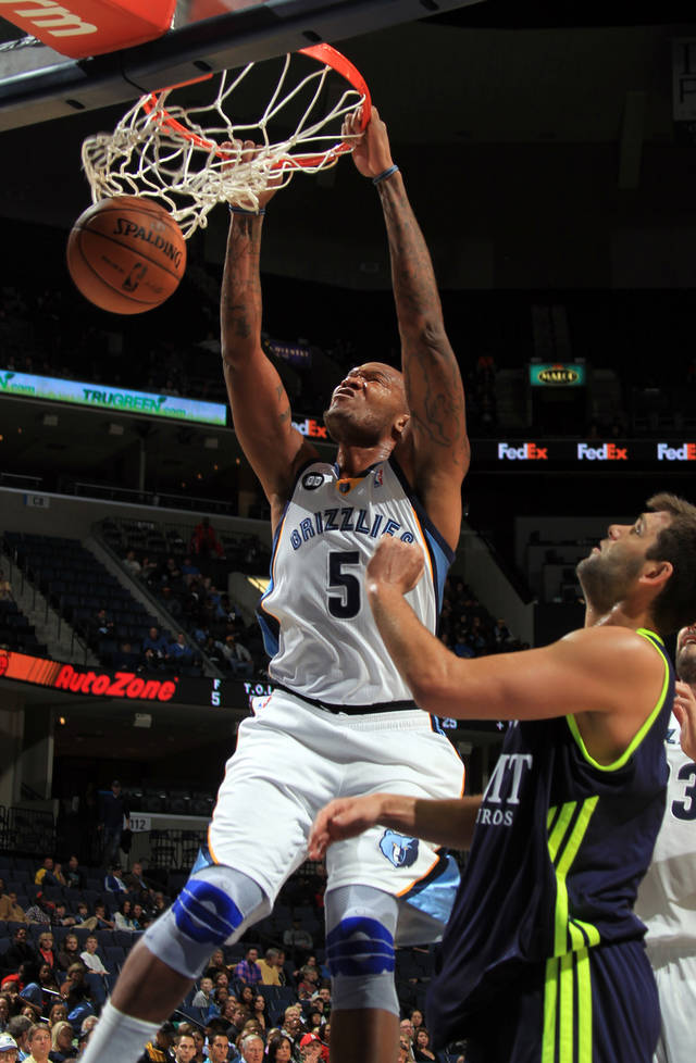 Memphis Grizzlies forward Marreese Speights (5) dunks defended by Real Madrid forward Filipe Reyes, right, in the first half of an NBA basketball preseason game on Saturday, Oct. 6, 2012, in Memphis, Tenn. (AP Photo/Nikki Boertman)