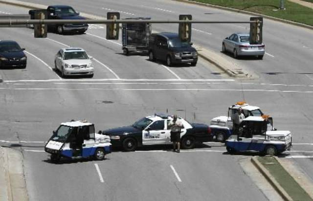 Oklahoma City Police investigators block sections of E.K. Gaylord in downtown Oklahoma City, OK, after a man committed suicide by jumping from the top of a parking garage, Tuesday, June 1, 2010. By  Paul  Hellstern