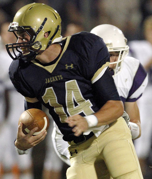 Kingfisher's Grant Newton tries to get past the Bethany defense during their high school football game in Kingfisher, Oklahoma on Friday, Oct. 14, 2011. Photo from The Oklahoman Archives ORG XMIT: KOD