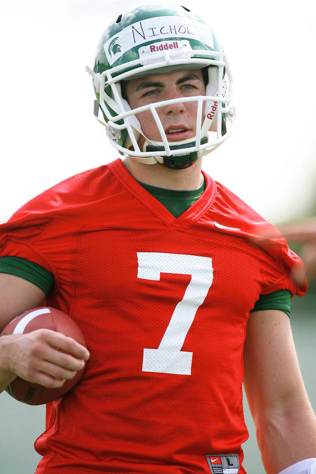 Michigan State quarterback Keith Nichol, who transferred from OU, listens during practice Tuesday.  AP Photo