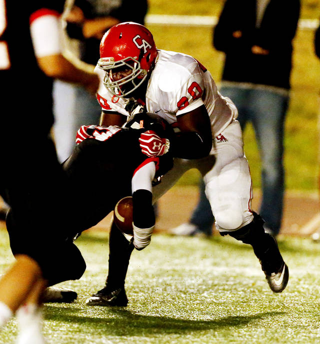Carl Albert's Chantz Woodberry stops Del City's Corey Lawrence for a loss in Class 5A, first round, playoff action in high school football on Friday, Nov. 9, 2012 in Del City, Okla.   Photo by Steve Sisney, The Oklahoman