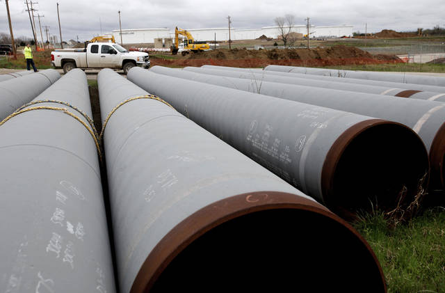 Large pipes ( 36 inches in diameter ) for carrying crude oil have been unloaded in a field near the TransCanada Corp. pipeline terminal on the south edge of Cushing. Residents and businesses of Cushing are preparing for the arrival of President Barack Obama this week. The president will make a brief stop at a TransCanada Corp. pipe yard northwest of town, as part of a four-state tour to promote the administration's energy  policy.  Ruth Ann Johnson, 73, who served 50 years as the town's librarian, said  the Payne County community of 8,000 will welcome President Obama on his first visit to Oklahoma after being elected in 2008.   Photo by Jim Beckel, The Oklahoman