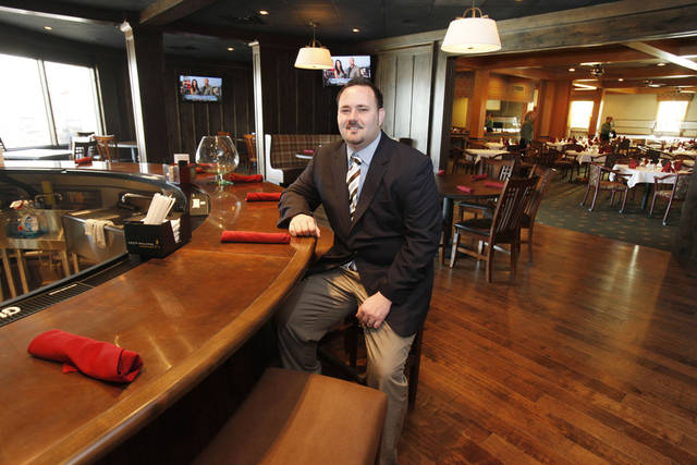General Manager Tom Wynn sits at the newly renovated bar at the Sportsman's Club in Oklahoma City, OK, Thursday, Jan. 19, 2012. By Paul Hellstern, The Oklahoman