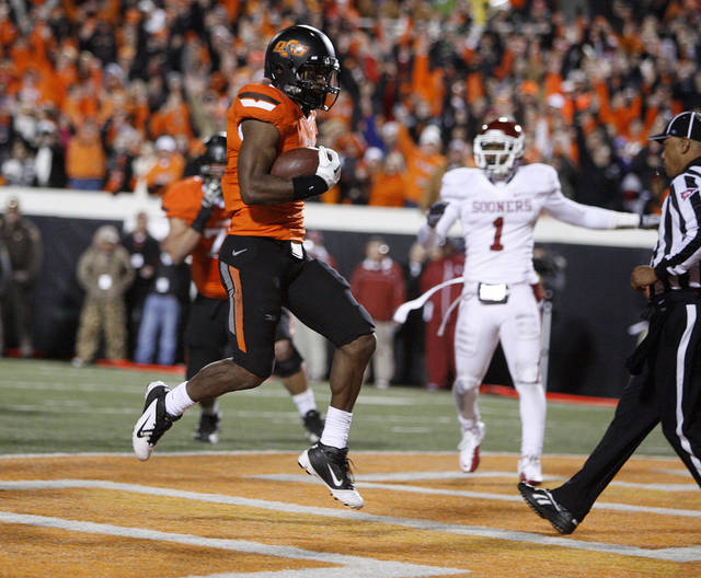 Oklahoma State's Joseph Randle (1) scores a touchdown during the Bedlam college football game between the Oklahoma State University Cowboys (OSU) and the University of Oklahoma Sooners (OU) at Boone Pickens Stadium in Stillwater, Okla., Saturday, Dec. 3, 2011. Photo by Bryan Terry, The Oklahoman