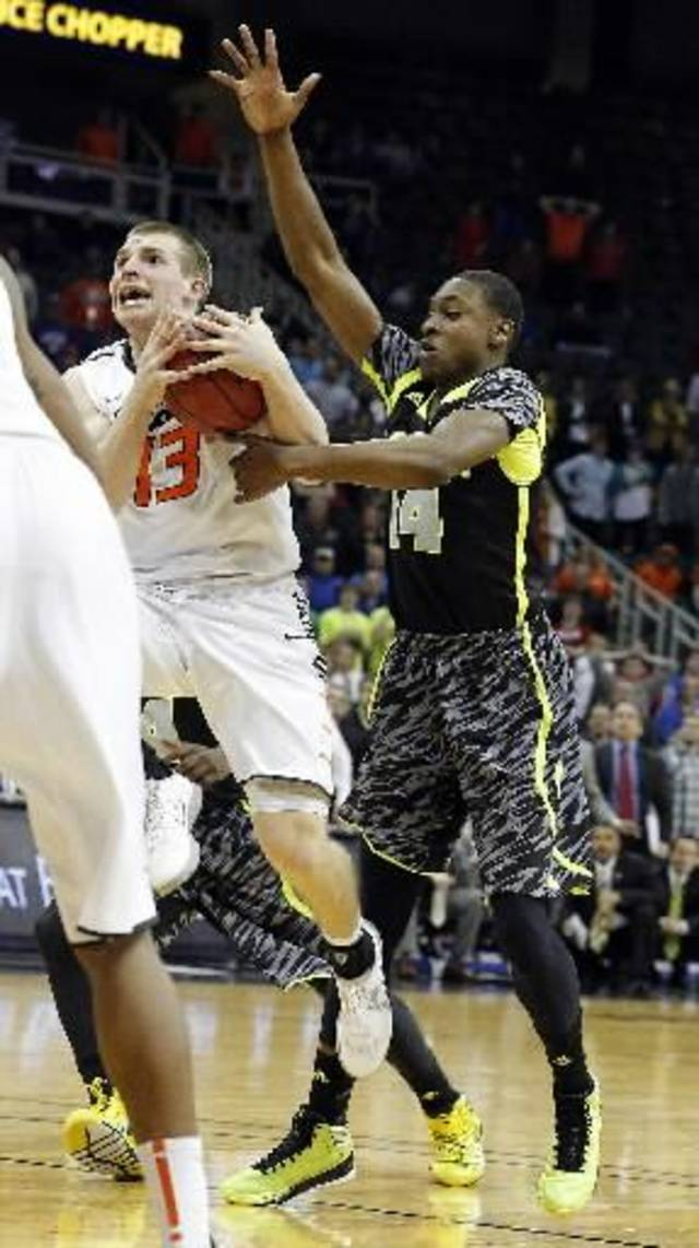 Oklahoma State's Phil Forte (13) is fouled in the final second of the Phillips 66 Big 12 Men's basketball championship tournament game between Oklahoma State University and Baylor at the Sprint Center in Kansas City, Thursday, March 14, 2013. Photo by Sarah Phipps, The Oklahoman