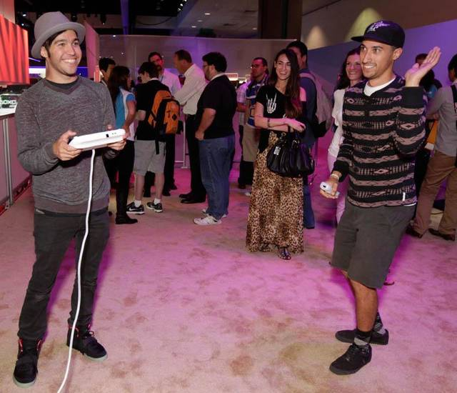 FILE - In this June 7, 2012 publicity file photo provided by Nintendo, Pete Wentz, left, and guests get an exclusive preview of Nintendo's Wii U during E3 in Los Angeles. (AP Photo/Nintendo,Todd Williamson)
