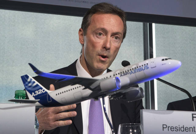 Airbus CEO Fabrice Bregier, gestures as he speaks during the annual press conference for commercial results in Toulouse, southwestern France, Thursday, Jan. 17, 2013. Airbus says it delivered a record 588 aircraft last year, while taking in gross order for 914 new jets, is well above its year earlier forecasts. A model of an Airbus 320 in the foreground. (AP Photo/Michel Euler)