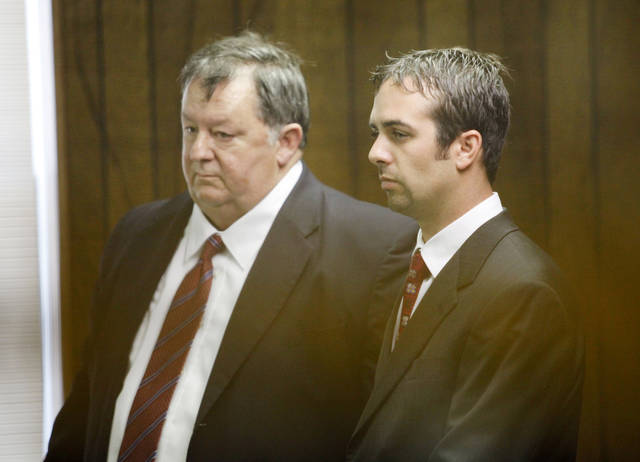 OHP: Defense attorney Carl Hughes, left and former Oklahoma Highway Patrol Trooper Patrick Venable make their initial court appearance in the Logan County Courthouse in Guthrie,  Tuesday, August 16, 2011. Photo by Steve Gooch ORG XMIT: KOD