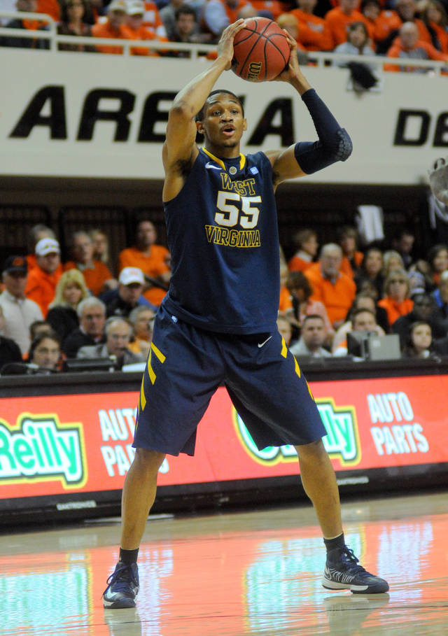 West Virginia forward Keaton Miles scans the court for a pass against Oklahoma State during an NCAA college basketball game in Stillwater, Okla., Saturday, Jan. 26, 2013. (AP Photo/Tulsa World, KT King)  ONLINE OUT; TV OUT; TULSA OUT