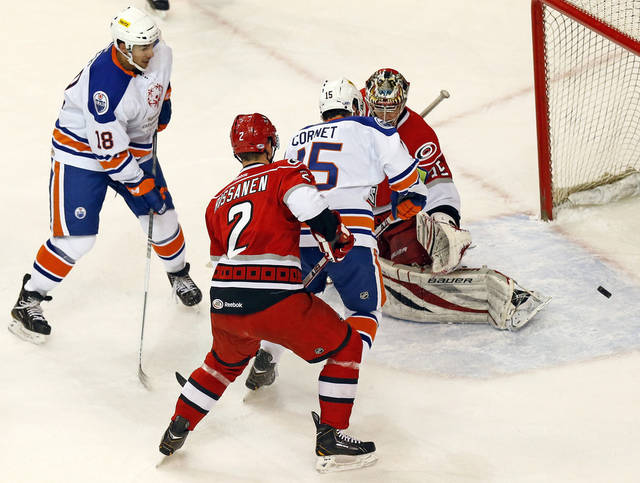 Oklahoma City's Jonathan Cheechoo (18) scores a goal against Charlotte goalie Justin Peters (35) next to Oklahoma City's Philippe Cornet (15) and Charlotte's Rasmus Rissanen (2) during an AHL hockey game between the Charlotte Checkers and the Oklahoma City Barons at the Cox Convention Center in Oklahoma City, Friday, Feb. 1, 2013. Photo by Nate Billings, The Oklahoman