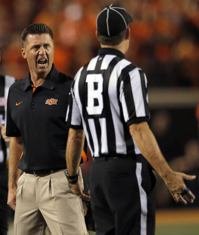 Oklahoma State head coach Mike Gundy argues a call during a college football game between Oklahoma State University (OSU) and the University of Texas (UT) at Boone Pickens Stadium in Stillwater, Okla., Saturday, Sept. 29, 2012. Texas on 41-36. Photo by Sarah Phipps, The Oklahoman