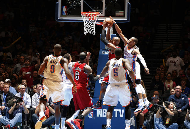 Oklahoma City's Russell Westbrook (0) blocks the shot of Miami's Ray Allen (34) during an NBA basketball game between the Oklahoma City Thunder and the Miami Heat at Chesapeake Energy Arena in Oklahoma City, Thursday, Feb. 15, 2013. Miami won 110-100. Photo by Bryan Terry, The Oklahoman