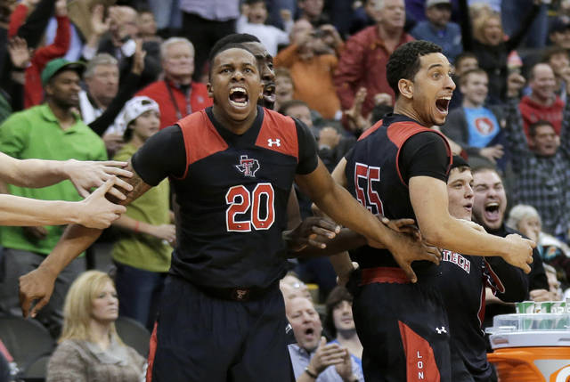 Texas Tech's bench celebrates after Dejan Kravic made the game-winning basket against West Virginia on Wednesday in Kansas City, Mo. Texas Tech won 71-69. AP Photo