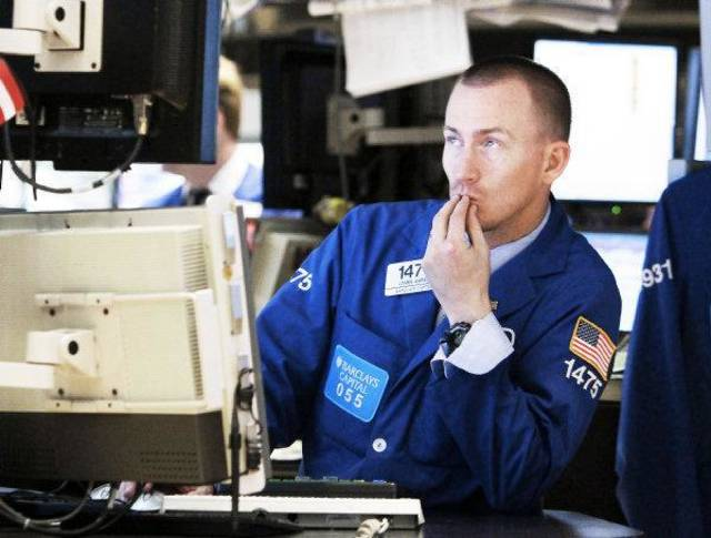 Specialist James Ahrens works on the floor of the New York Stock Exchange Tuesday. AP Photo <strong>Richard Drew</strong>