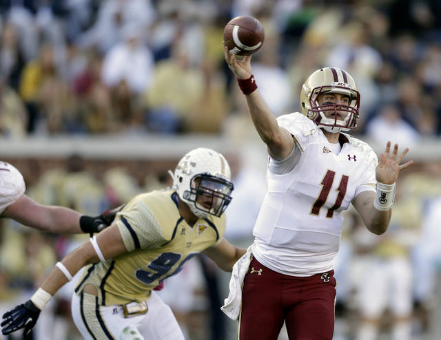 Boston College quarterback Chase Rettig, right, throws an incomplete pass as Georgia Tech defensive lineman Adam Gotsis, rear, looks on during the fourth quarter of an NCAA college football game, Saturday, Oct. 20, 2012, in Atlanta. Georgia Tech won 37-17. (AP Photo/David Goldman)