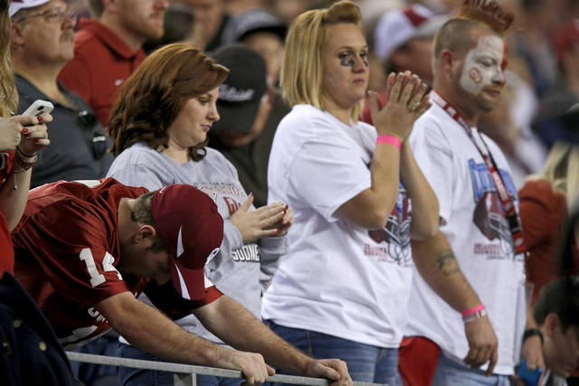 Oklahoma fans react during the Cotton Bowl college football game between the University of Oklahoma (OU)and Texas A&amp;M University at Cowboys Stadium in Arlington, Texas, Friday, Jan. 4, 2013. Oklahoma lost 41-13. Photo by Bryan Terry, The Oklahoman