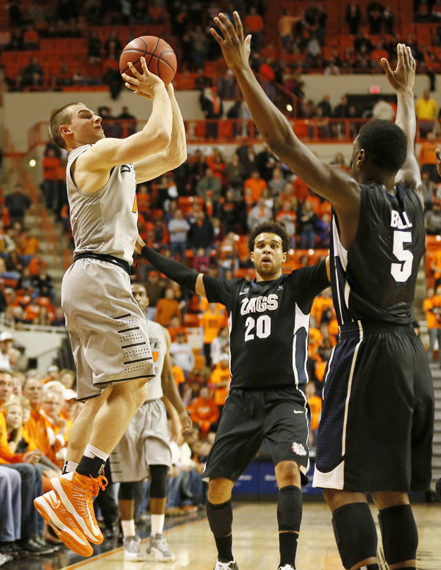 Oklahoma State's Phil Forte (10) takes a last-second shot against Gonzaga's Elias Harris (20) and Gary Bell, Jr., (5) during a men's college basketball game between Oklahoma State University (OSU) and Gonzaga at Gallagher-Iba Arena in Stillwater, Okla., Monday, Dec. 31, 2012. Gonzaga won, 69-68. Photo by Nate Billings, The Oklahoman
