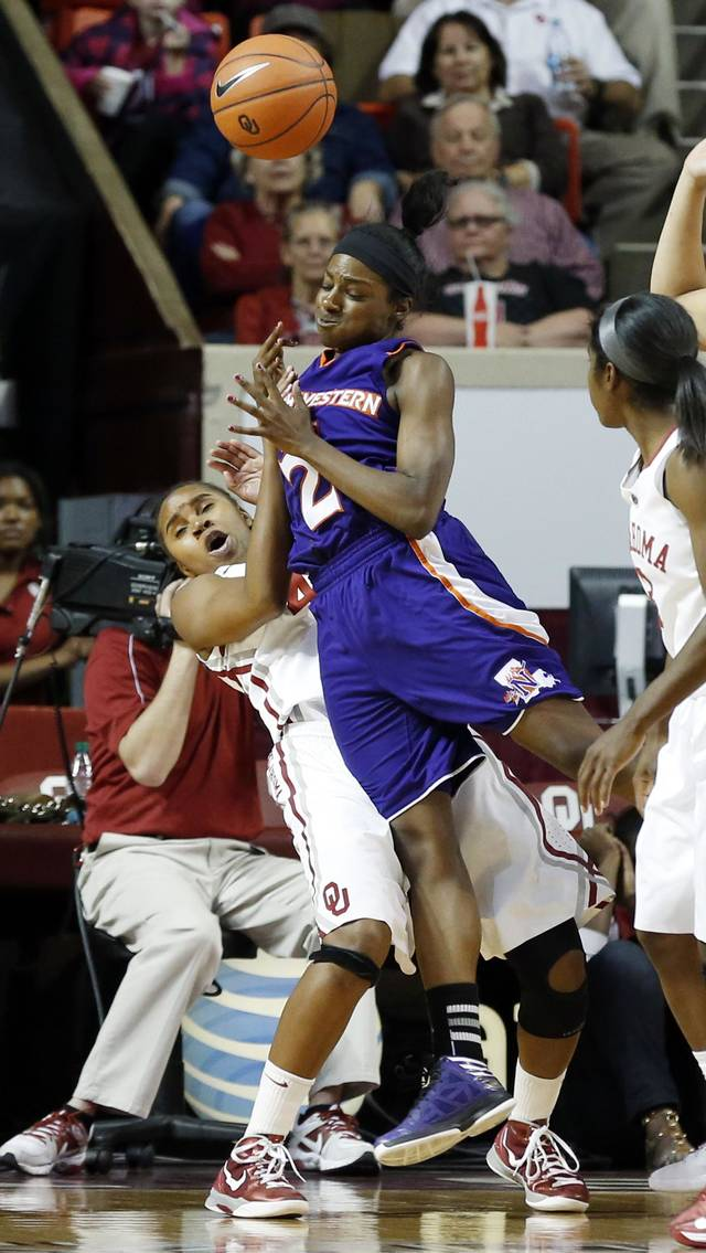 Northwestern State Lady Demons' Tiandra Williams (2) runs over Oklahoma Sooners' Jasmine Hartman (45) on her way to the basket as the University of Oklahoma (OU) Sooner women's basketball team plays the Northwestern State Lady Demons at the Lloyd Noble Center on Thursday, Nov. 29, 2012  in Norman, Okla. (AP PHOTO/The Oklahoman, Steve Sisney)