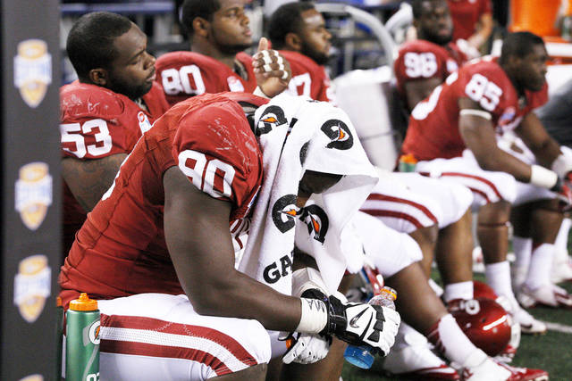 Oklahoma�s David King, front, sits on the bench during the Cotton Bowl on Friday. Oklahoma lost 41-13. Photo by Bryan Terry, The Oklahoman