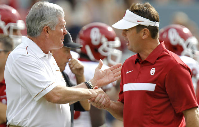 Oklahoma coach Bob Stoops and Mack Brown shake hands before the start of the Red River Rivalry college football game between the University of Oklahoma Sooners (OU) and the University of Texas Longhorns (UT) at the Cotton Bowl in Dallas, Saturday, Oct. 8, 2011. Photo by Chris Landsberger, The Oklahoman  ORG XMIT: KOD