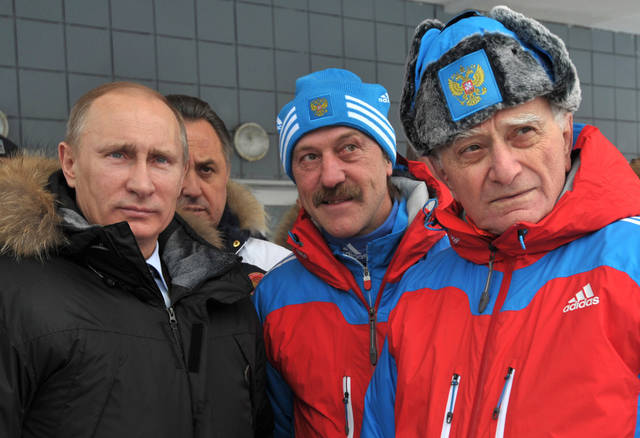 From left: Russian Prime Minister and presidential candidate Vladimir Putin, Russian sports minister Vitaly Mutko, Wolfgang Schadler, Russian national luge team coach, and Alexander Shakhnazarov, Russian luge federation president advisor visit the sports center in Paramonovo, outside Moscow, Russia, Thursday, Feb. 16, 2012.(AP Photo/RIA Novosti, Alexei Nikolsky, Government Press Service)