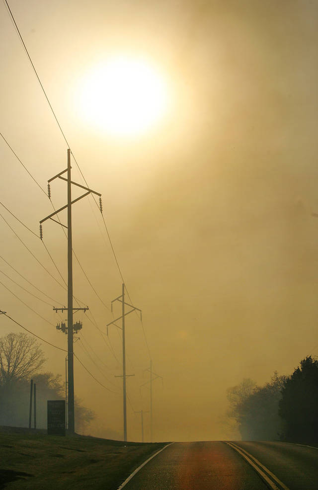 Late afternoon sun is obscured by heavy smoke as a result of multiple fires sparked by wildfires in Midwest City, Okla.,  Thursday, April 9, 2009.  Photo by Jim Beckel, The Oklahoman