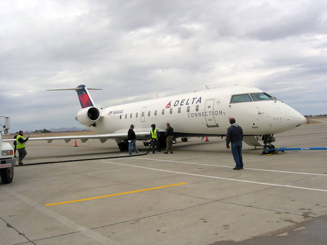 Delta crew refuel the regional jet before the afternoon non stop flight from Lawton-Fort Sill Regional Airport to Atlanta, Monday, March 3, 2008. Photo by Ja'Rena Lunsford