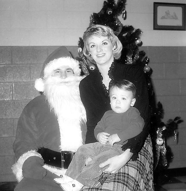 Josh Fields, a former Oklahoma State quarterback and third baseman, is pictured on the lap of his mom, Rhonda, during Christmas. Fields, 1 at the time of the picture in 1983, returned to Oklahoma City over the weekend with the Albuqurque Isotopes against the Oklahoma City RedHawks. Once a highly touted prospect, Fields is looking to return to the majors with the Dodgers.  Photo from The Oklahoman Archives