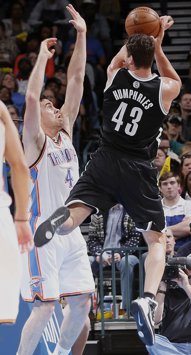 Oklahoma City's Nick Collison (4) defends on Brooklyn Nets' Kris Humphries (43) during the NBA basketball game between the Oklahoma City Thunder and the Brooklyn Nets at the Chesapeake Energy Arena on Wednesday, Jan. 2, 2013, in Oklahoma City, Okla. Photo by Chris Landsberger, The Oklahoman