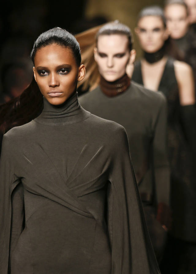 Fashion from the Fall 2013 collection of Donna Karan New York is modeled on Monday, Feb. 11, 2013 in New York.  (AP Photo/Bebeto Matthews)