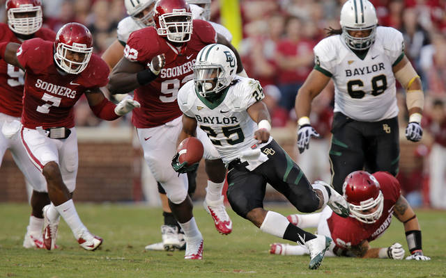 Baylor&#039;s Lache Seastrunk (25) races past the Oklahoma defense during the college football game between the University of Oklahoma Sooners (OU) and Baylor University Bears (BU) at Gaylord Family - Oklahoma Memorial Stadium on Saturday, Nov. 10, 2012, in Norman, Okla.  Photo by Chris Landsberger, The Oklahoman