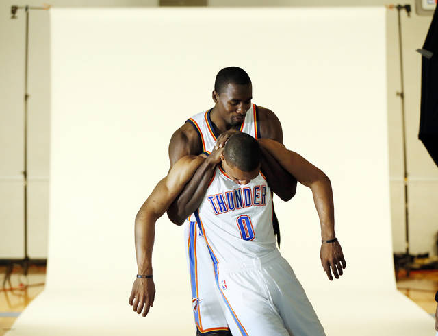 Serge Ibaka, back, jokes around with Russell Westbrook during media day for the Oklahoma City Thunder NBA basketball team at the Thunder Events Center in Oklahoma City, Monday, Oct. 1, 2012.  Photo by Nate Billings, The Oklahoman