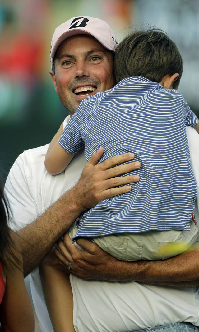 Matt Kuchar holds his son Cameron, 4, after winning the Players Championship golf tournament at TPC Sawgrass, Sunday, May 13, 2012, in Ponte Vedra Beach, Fla. (AP Photo/David Goldman)