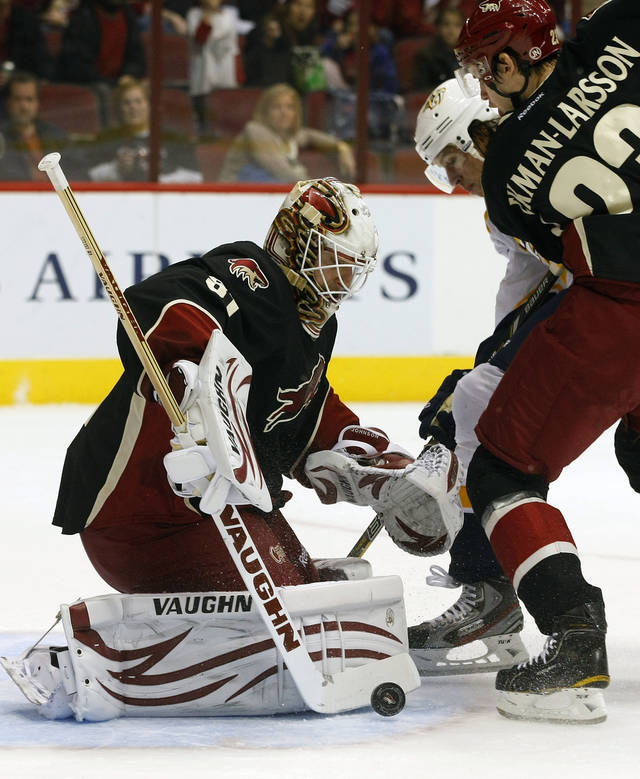 Phoenix Coyotes goalie Chad Johnson (31) makes the save against the Nashville Predators in the first period during an NHL hockey game on Monday, Jan. 28, 2013, in Glendale, Ariz. (AP Photo/Rick Scuteri)