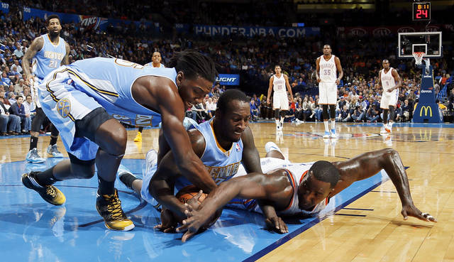 Denver's Kenneth Faried (35), left, and J.J. Hickson (7) fight for the ball with Oklahoma City's Kendrick Perkins (5) in the first half during an NBA basketball game between the Oklahoma City Thunder and the Denver Nuggets at Chesapeake Energy Arena in Oklahoma City, Monday, Nov. 18, 2013. Photo by Nate Billings, The Oklahoman
