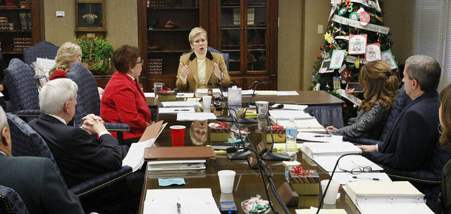 State schools Superintendent Janet Barresi, center, talks about security and safety in schools at the beginning of Wednesday�s state Board of Education meeting in Oklahoma City. Photo by Paul B. Southerland, The Oklahoman