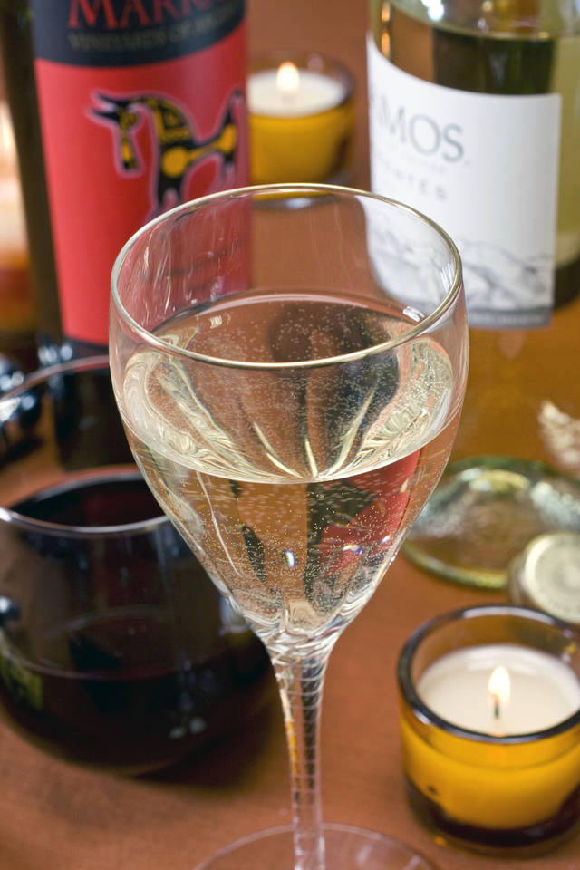 A wine industry report says grapes, such as used to make the wine in this glass, will be in short supply in the next few years. AP File Photo